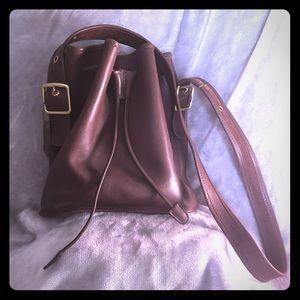 Vintage Coach bucket bag in mahogany w/adj strap.